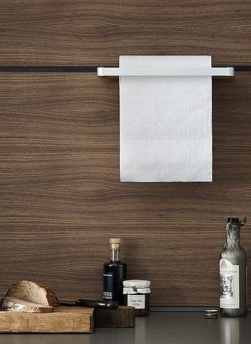 Elegant kitchen roll holder mounted to the panel wall