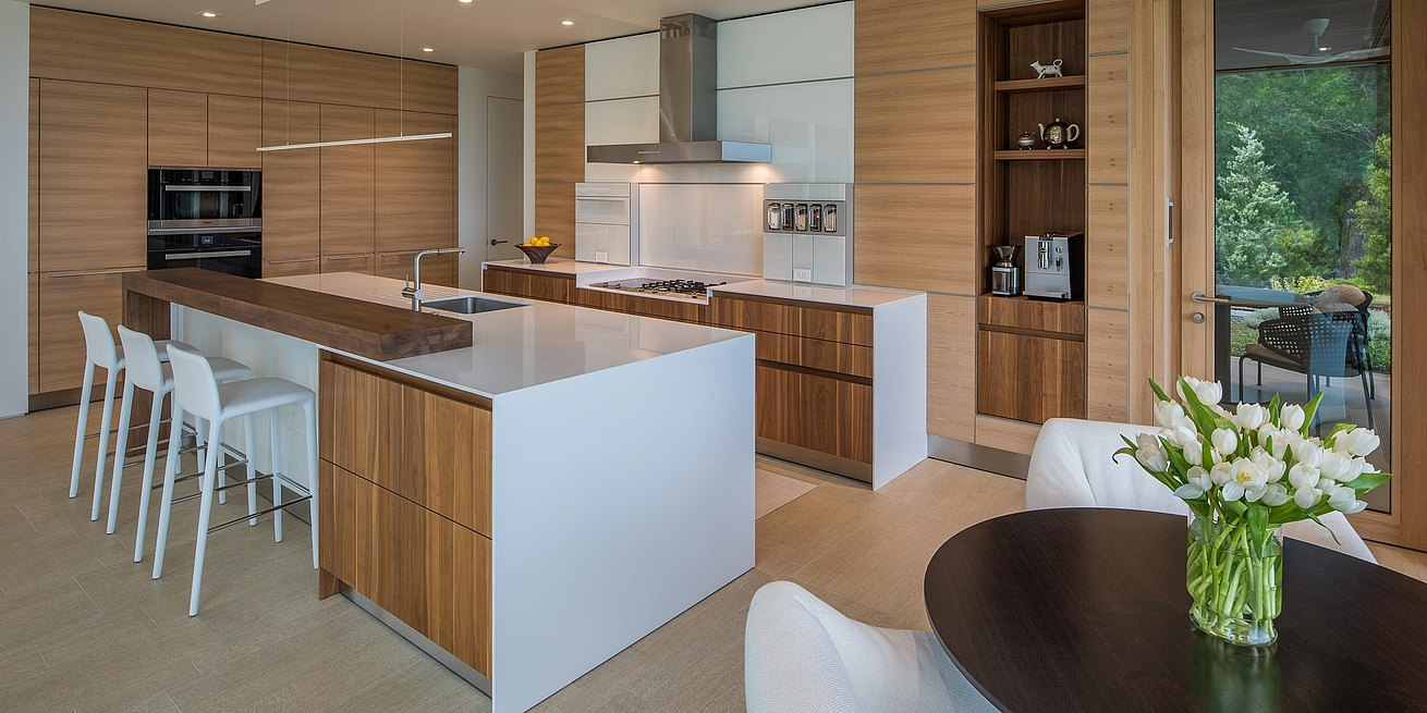 b3 kitchen in elm wood veneer, solid walnut and white glass.