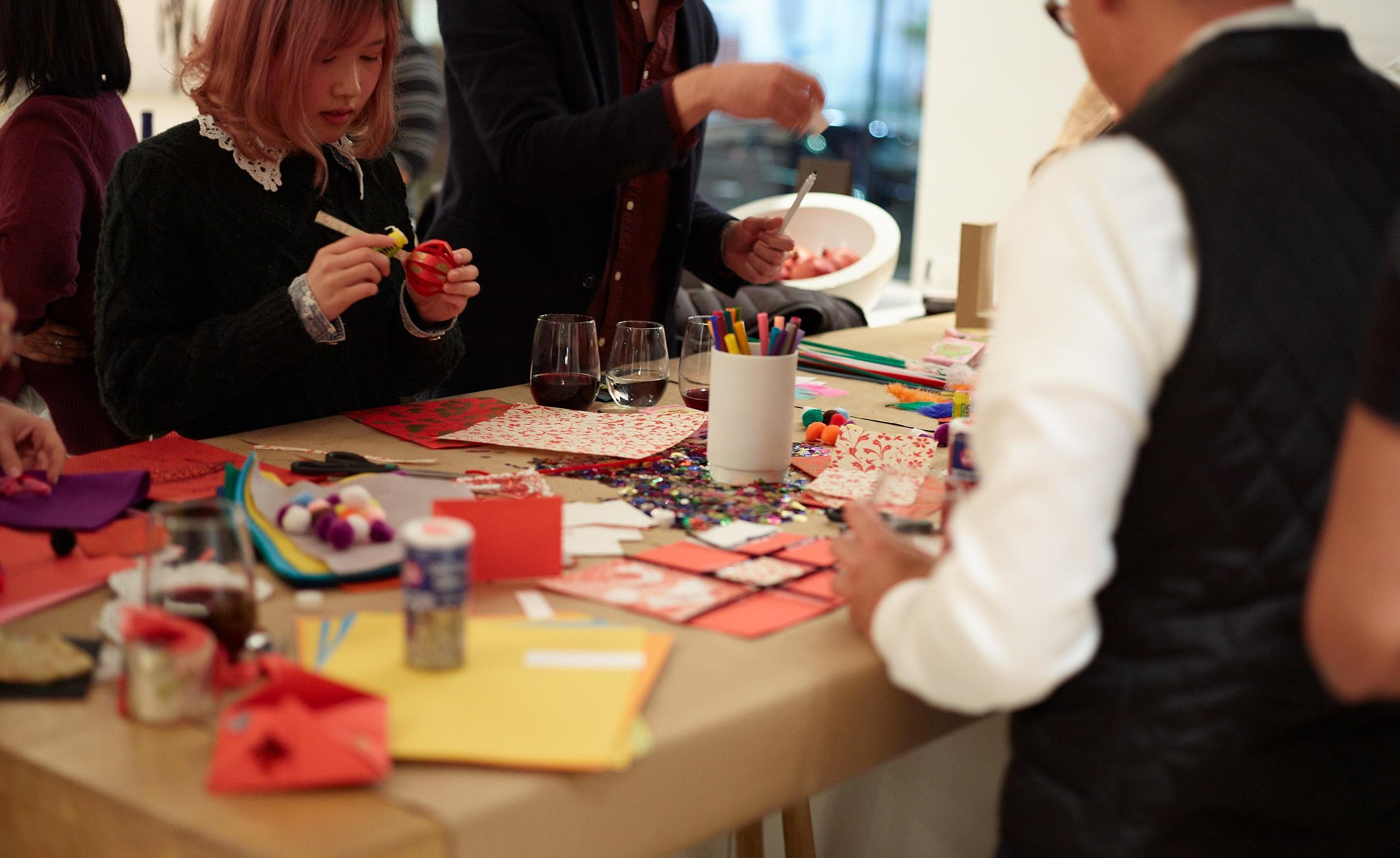 Detail of guests happily creating valentines at b3 work top.