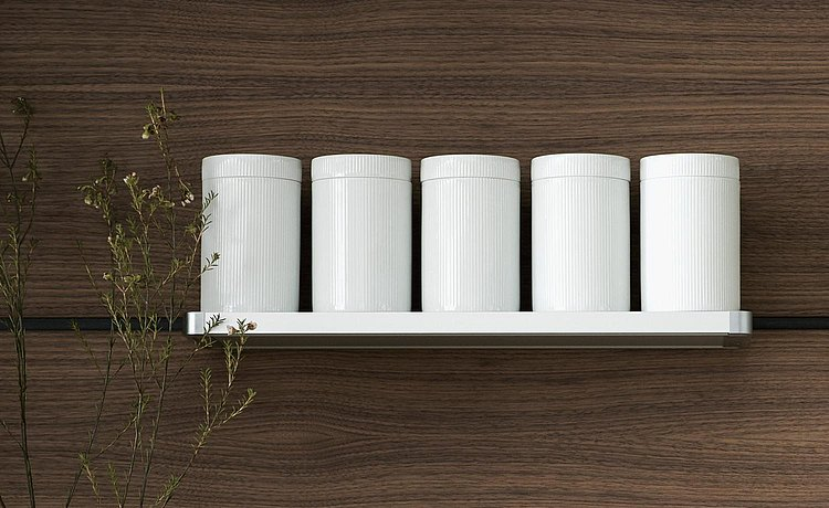 Round white storage jars in grooved porcelain. Understated, smart and functional
