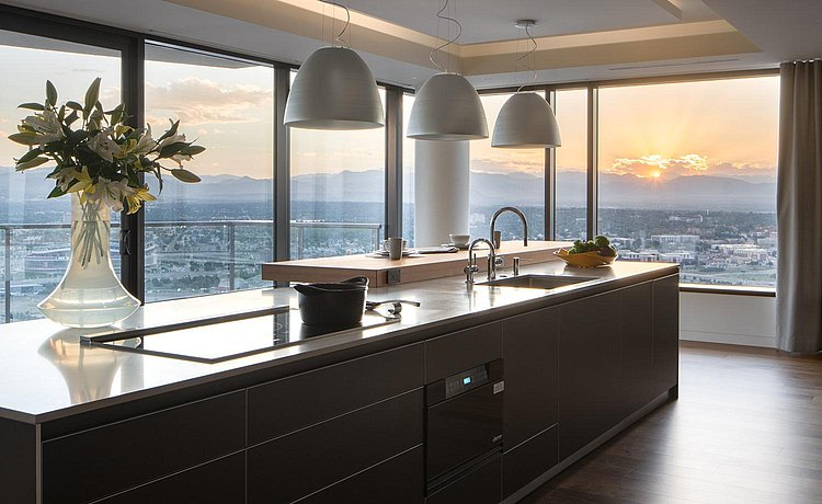 b3 kitchen in bronze anodized aluminum, white quartz and Walnut bar top in a penthouse setting with exquisite sunset view.