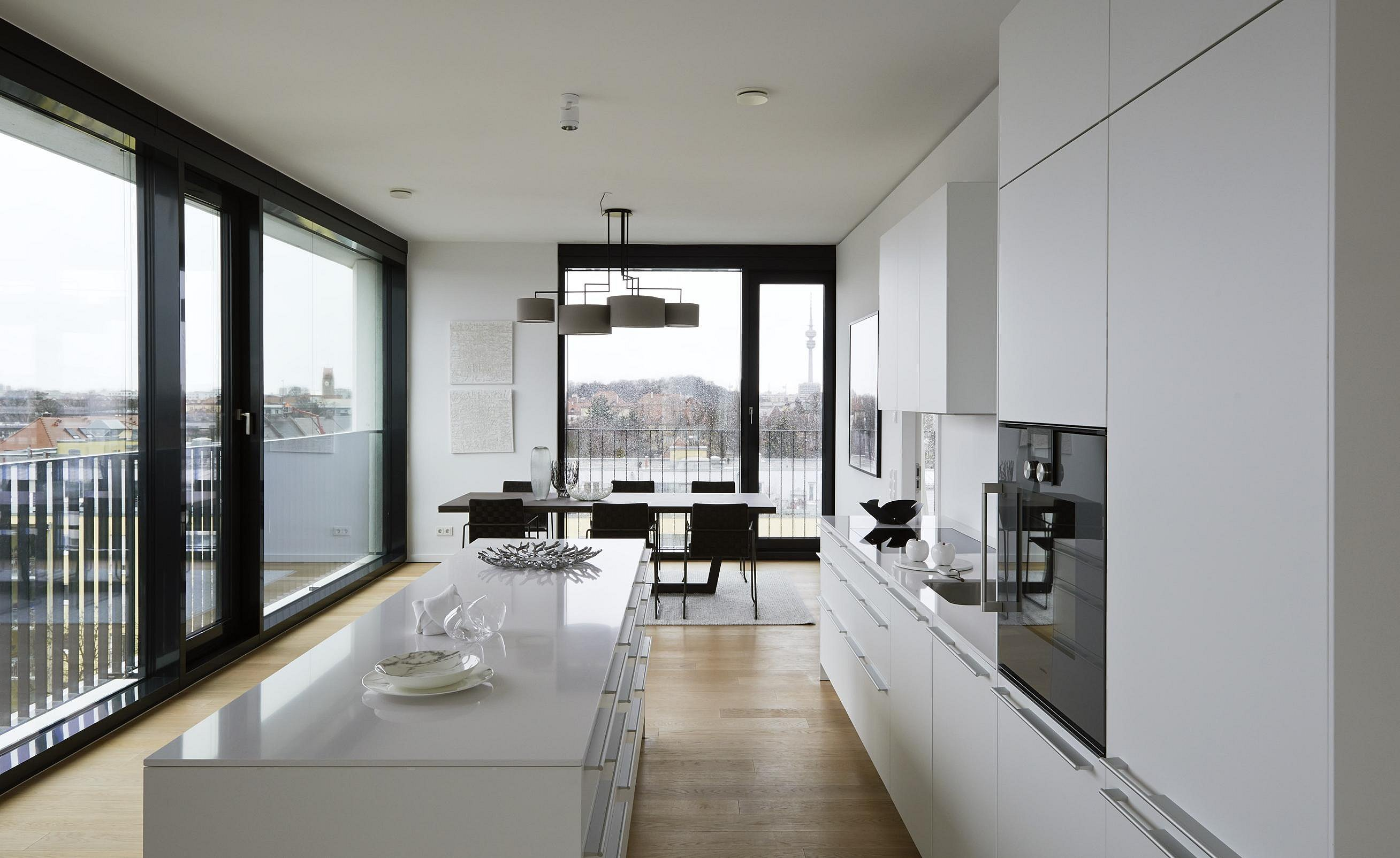 Generous white b3 with wall line and kitchen island in the large apartments