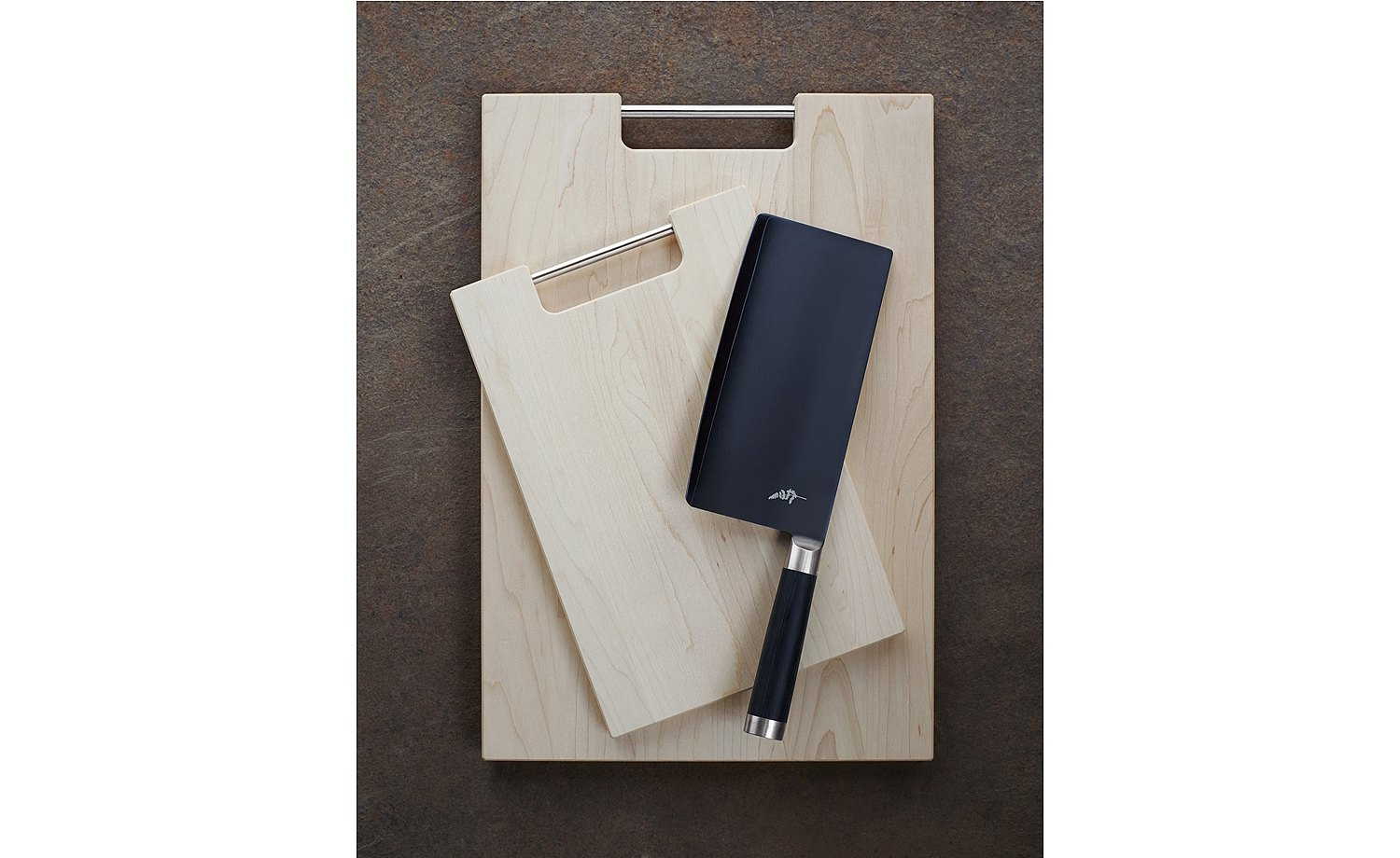 Maple chopping board in various sizes with practical metal handle