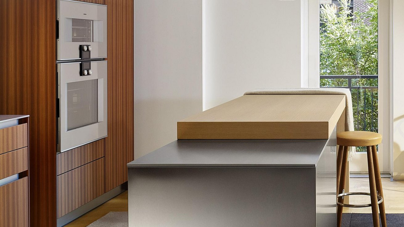 Details of b3 kitchen featuring bar top in oak and lush finish of stainless steel surfaces.