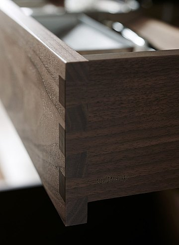 Great craftsmanship: wooden drawer with perfectly processed finger joint connection