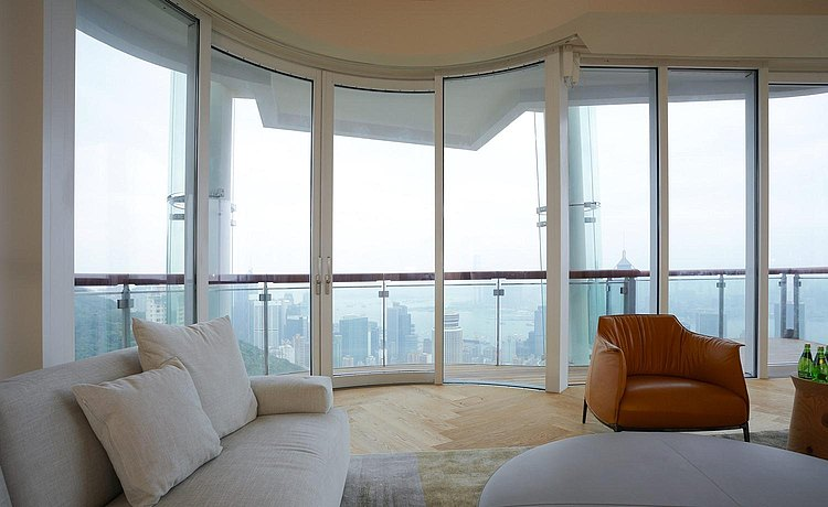 Interior view: the living space with semi-circular floor to ceiling windows provides an extraordinary view of the city