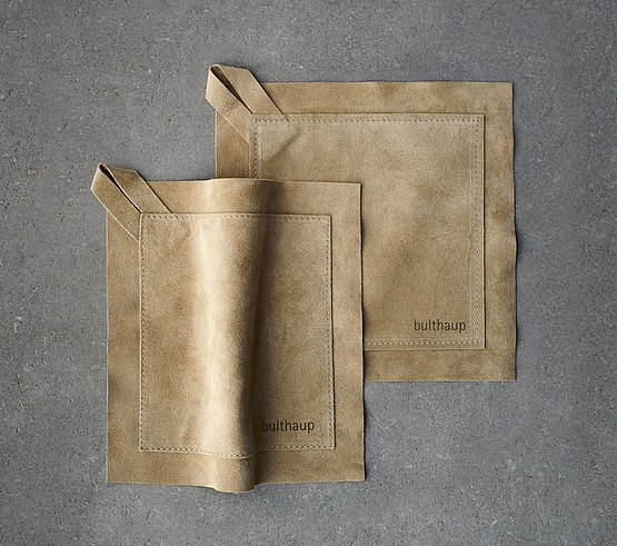 Soft leather potholders caress and protect the hands