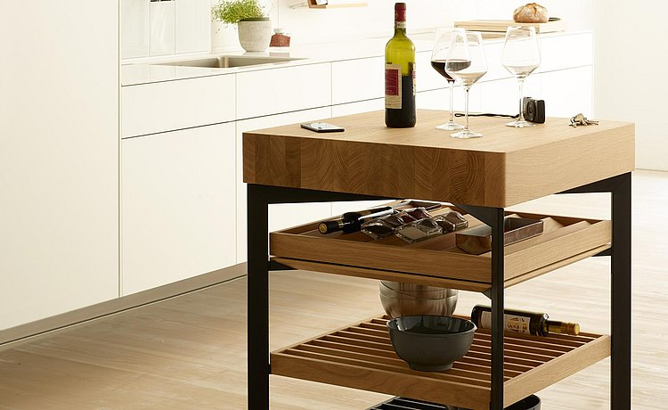 Perfect place for wine accessories or for serving the roast next to the table