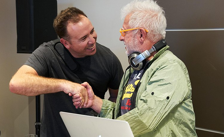 Guest shaking hands with DJ at bulthaup Los Angeles showroom reopening party.