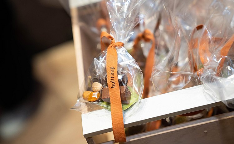 Detail of thank you gift chocolates with bulthaup ribbon.