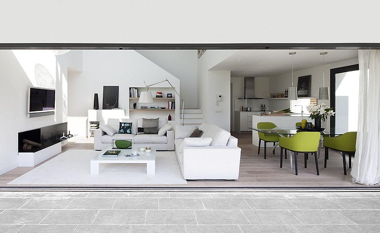 Open-plan living space which begins with the b3 in white and continues through the dining and living area