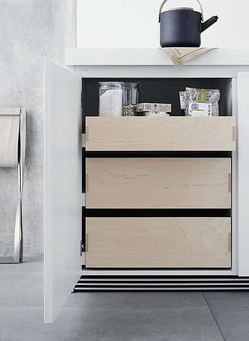 Easy access due to different height drawers behind the cabinet door