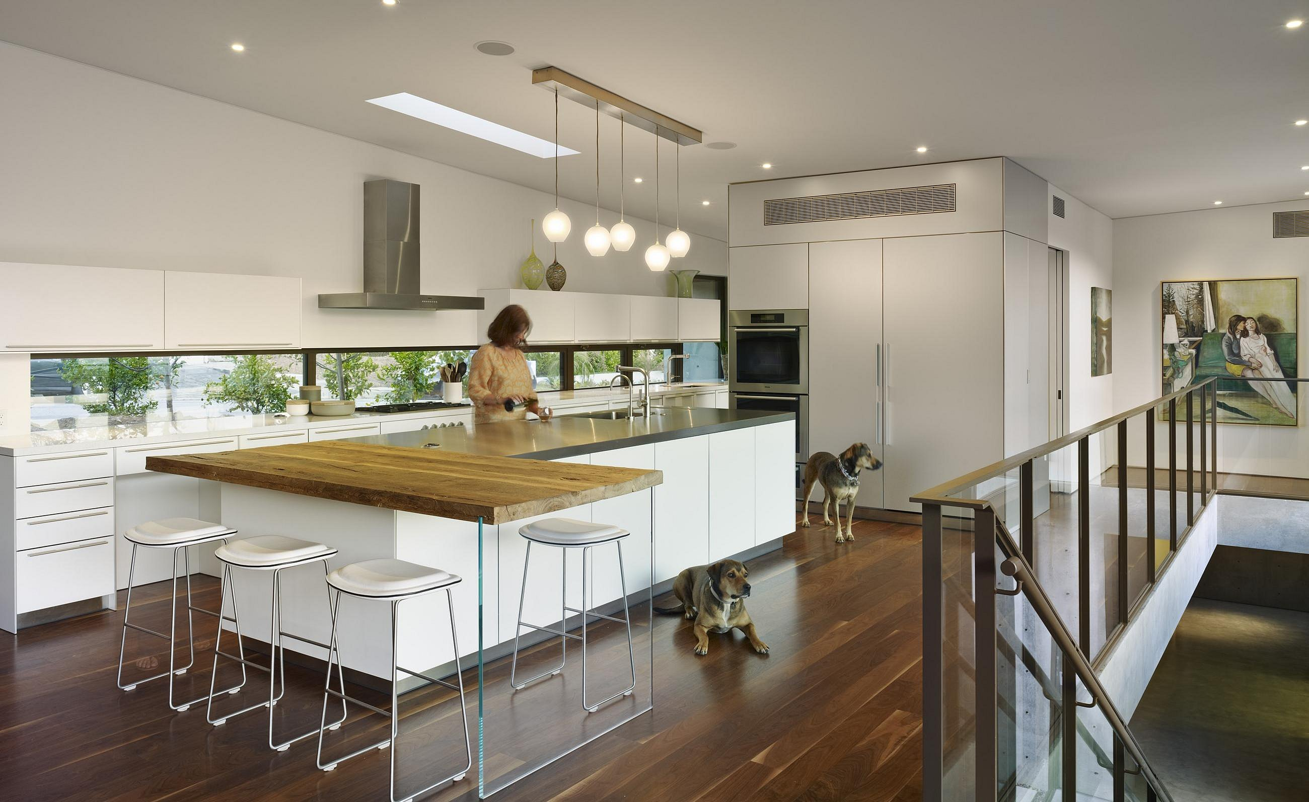 b3 kitchen in alpine white laminate, natural aluminum and stainless steel.