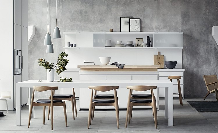 c2 table: white table with robust top. Table surface and legs look like as if they are made from one continuous piece of material