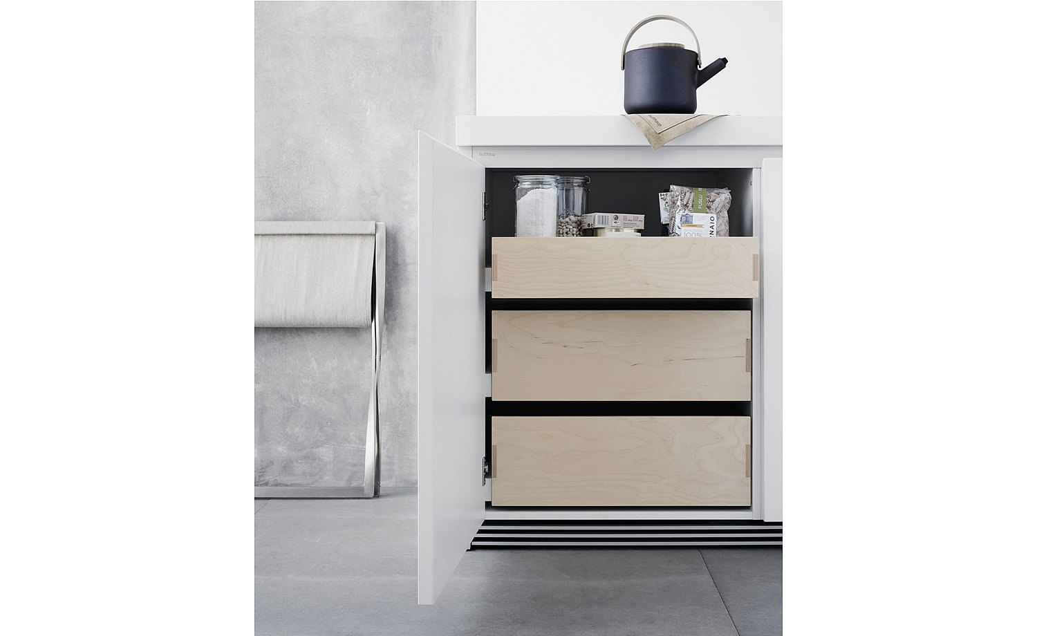 Different height drawers behind the front door panels make the cabinet contents particularly easy to access