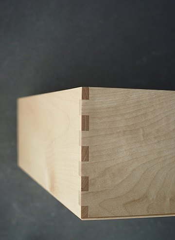 Premium-crafted boxes made from light wood for customizable storage space