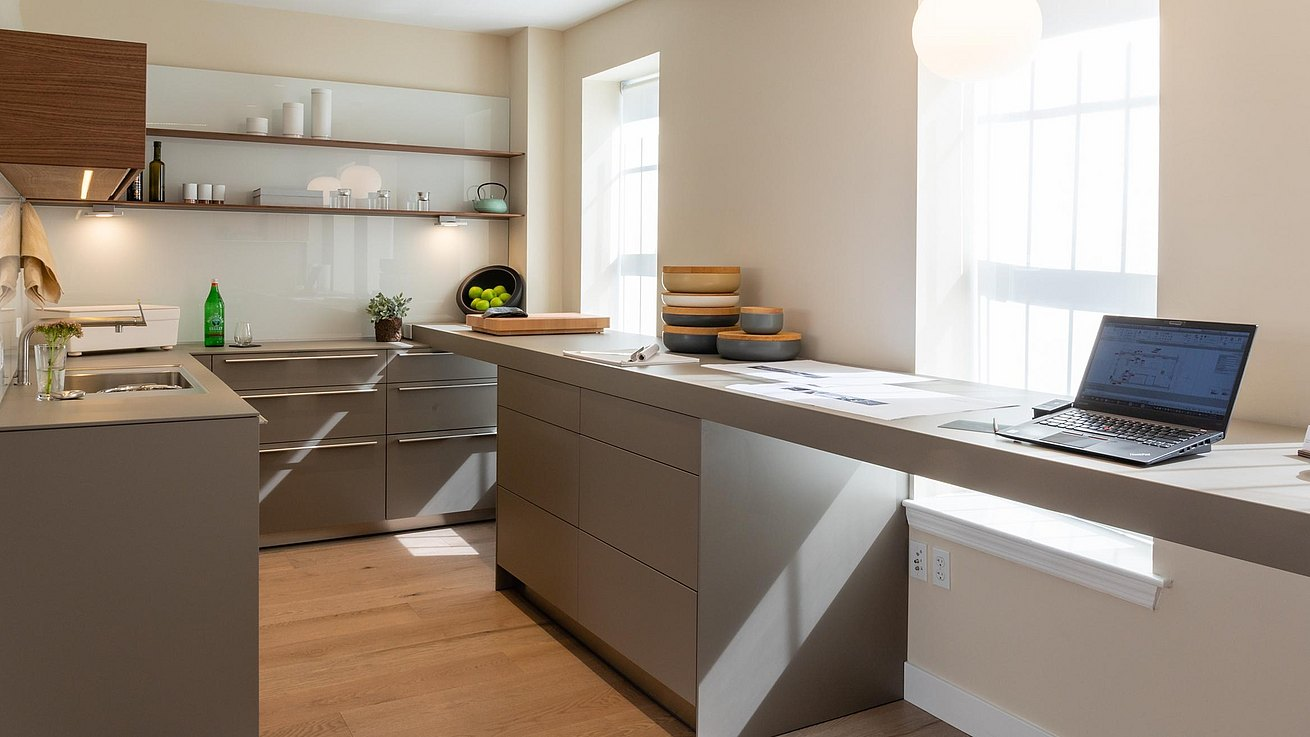 View of bulthaup atelier rear b3 kitchen combined seamlessly with work area for the designer.