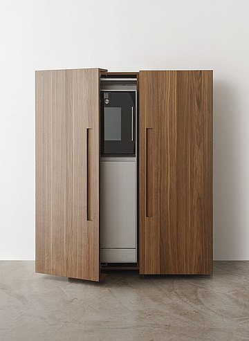 The equipment cabinet easily hides away kitchenware and creates a harmonious atmosphere in the living space