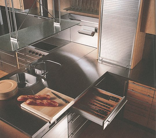 Functional equipment such as sliding doors and prisms in the drawers, which also serve as a design element