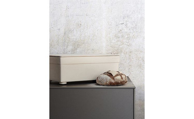 Bread container made from light stoneware with natural maple grain wooden lid, which serves as a bread cutting board