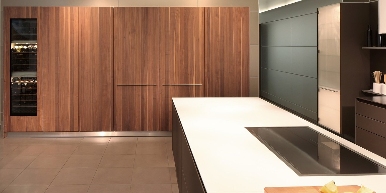 Detail view of b3 cabinets in Solid walnut with doors closed.