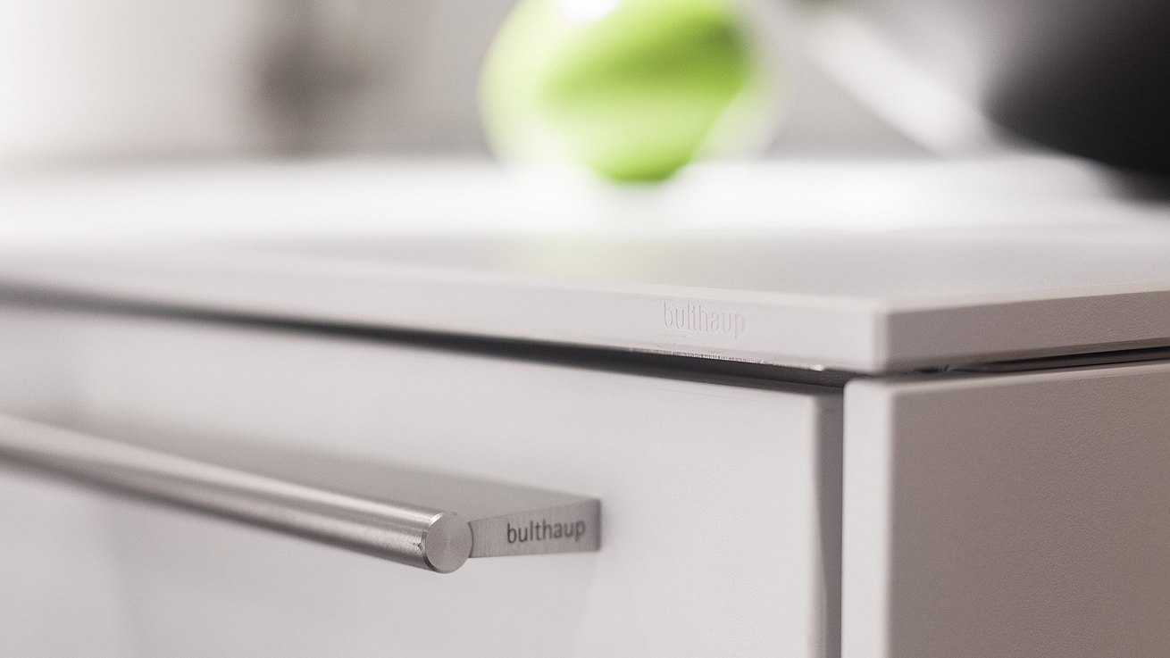 Detail of bulthaup stainless steel drawer pull.
