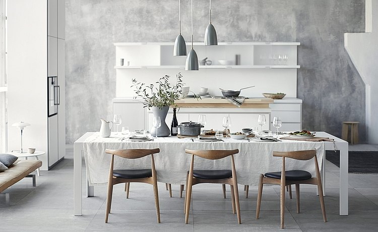 c2 table set for a wonderful lunch, in front of b1 with tall cabinet and kitchen unit and island: a welcoming and harmonious image