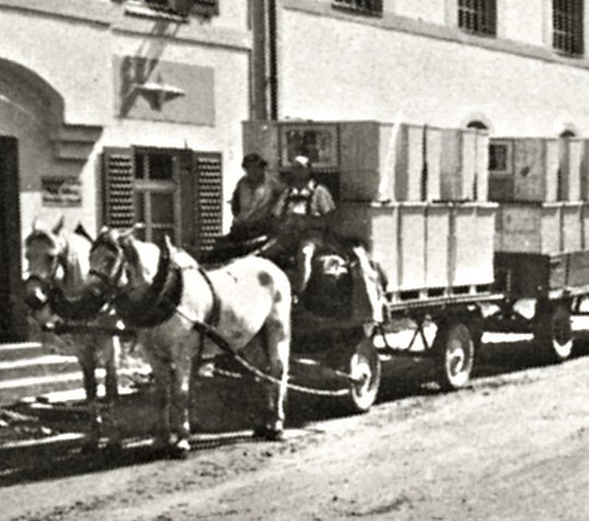 Horse-drawn carriage delivers packaged kitchen sideboards in crates
