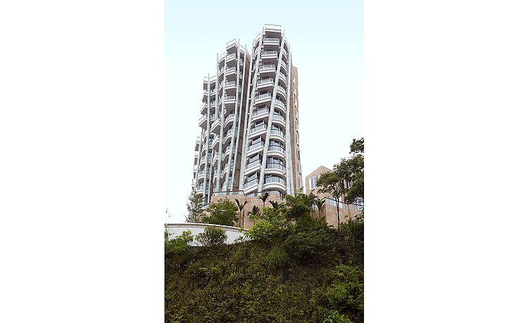 Exterior view: the apartment building comprises of several curved towers