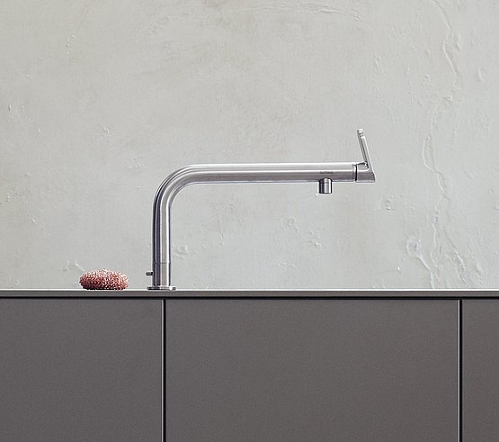 A single-lever faucet attached to the work surface