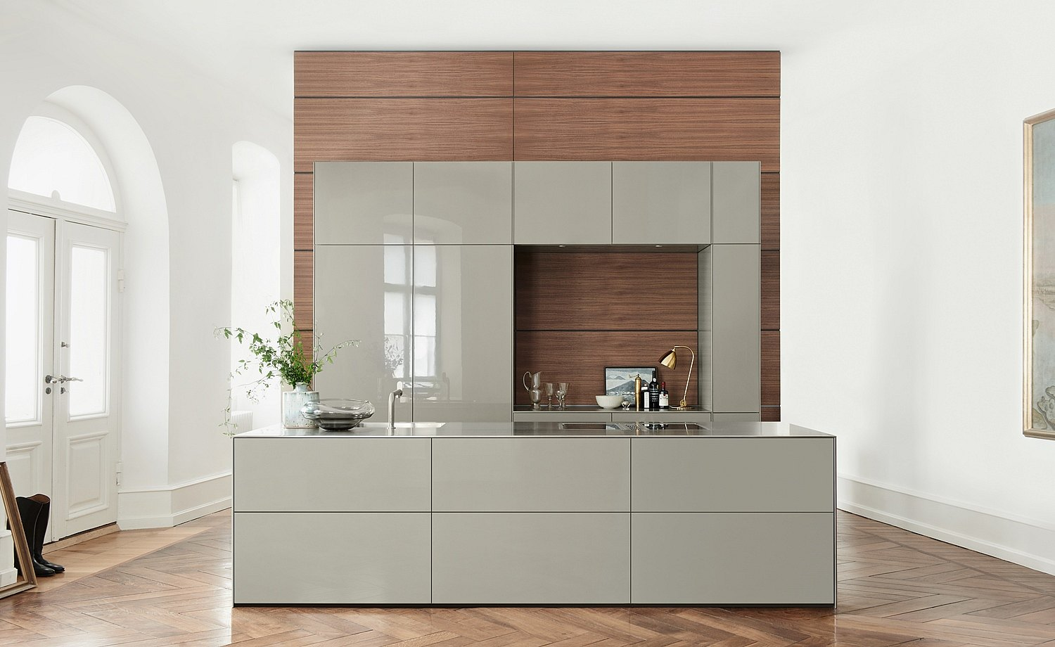 b3 with cabinets and island with gray lacquer front panels in front of the functional wall made from dark veneer