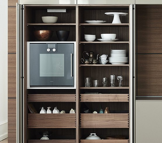Sliding doors that pivot and glide sideways along the cabinet to keep the way clear