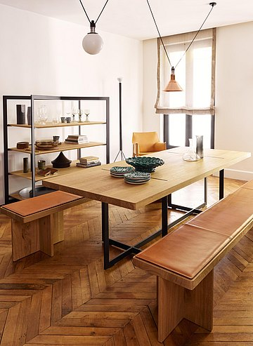 The table/bench combination offers plenty of space for eating and living