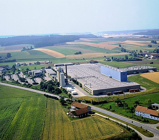 New company location viewed from the air: large production halls next to the office buildings