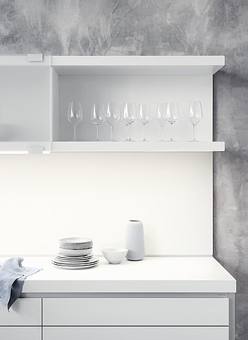 Wall line comprises of base cabinets and a shelf with sliding frosted glass front panels
