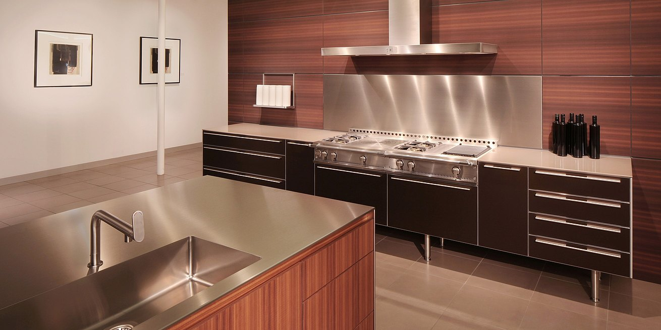 b3 kitchen in walnut, bronze anodized aluminum and stainless steel.