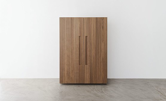 The two-door tool cabinet made from premium wood as a compact design element