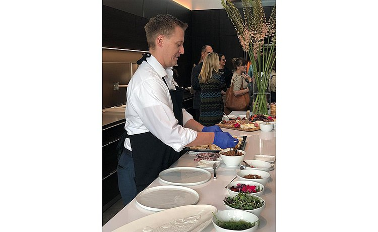 Chef Daniel McQueen preparing hors-d'oeuvres on center island