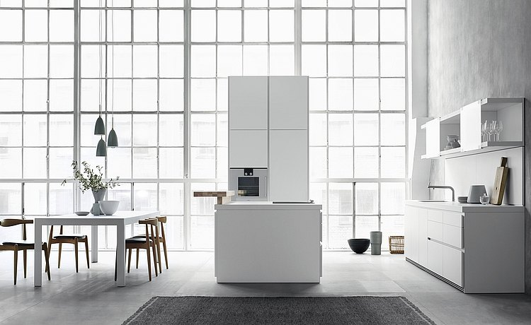 b1 is always white in order to support the purist design: wall unit, cabinet and island form the centerpiece of the room