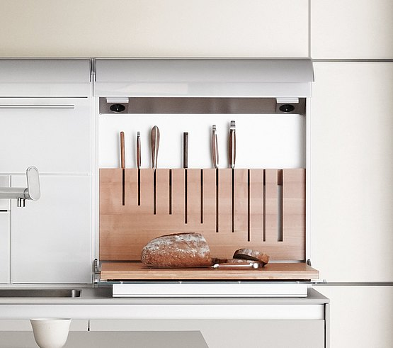 The function box hides a knife block in the wall and contains a chopping board in the flap door