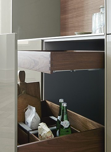 Different height pull-outs in a single drawer create functional yet aesthetic storage space