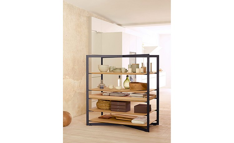 b Solitaire shelf as both a separating and connecting element between kitchen and living space