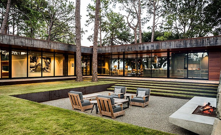 Exterior courtyard with outdoor furniture and fireplace