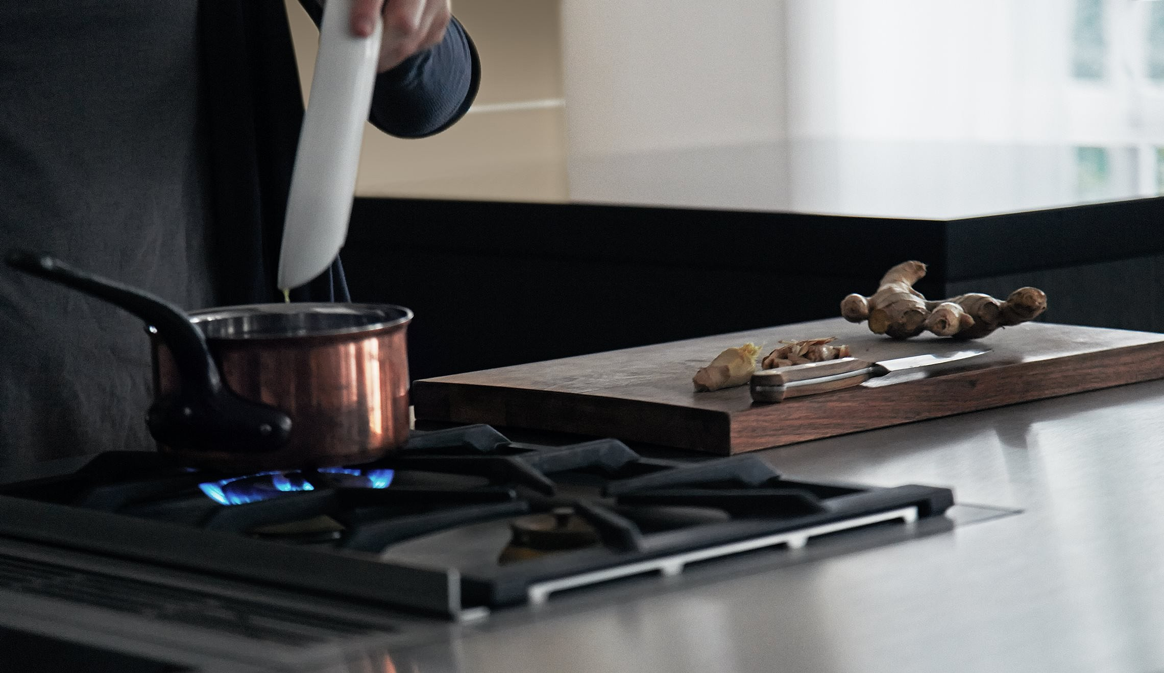 Gas stove integrated into the kitchen island for plenty of room and flexibility for food preparation