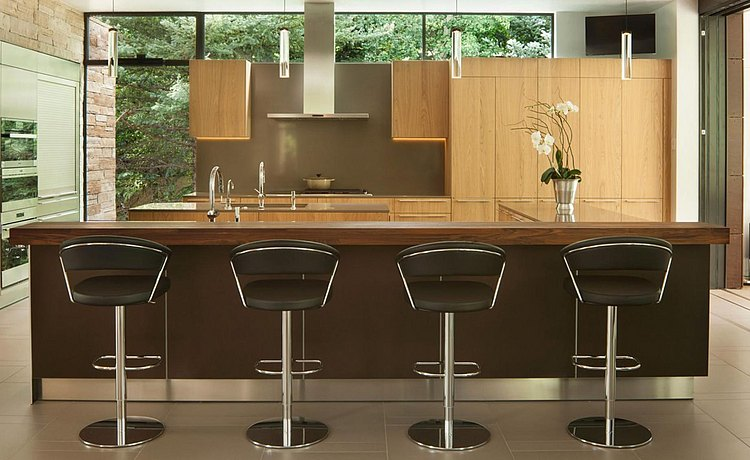 Combination of bronze aluminum base cabinets with structure natural oak finishes. Offering causal bar top seating