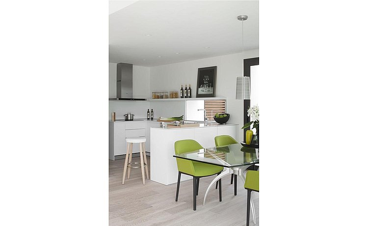 The kitchen structure offers an ideal connection to the dining area for serving dishes