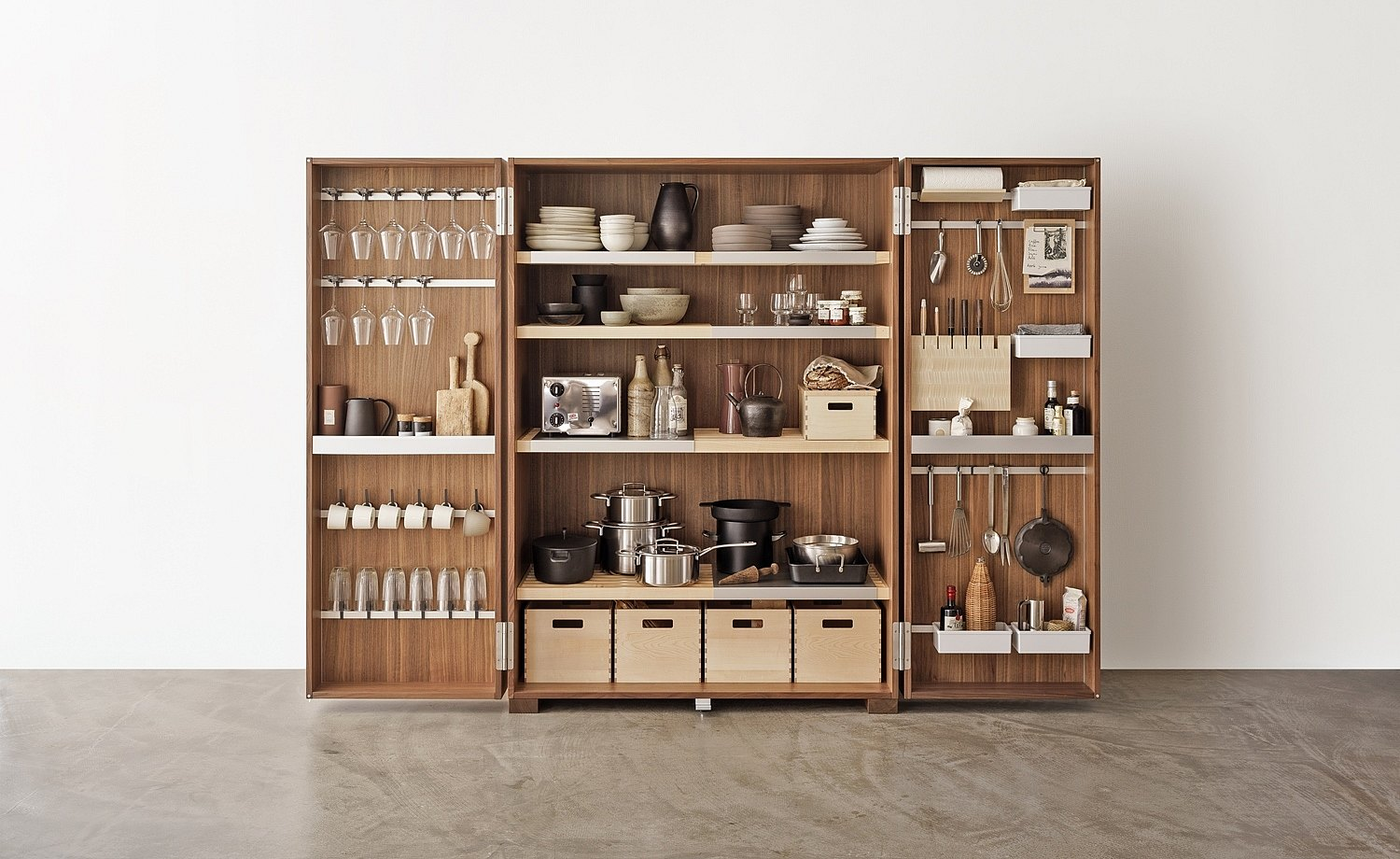 Practically equipped tool cabinet with armature for storing glasses, shelves, compartments, boxes, rods, and knife block